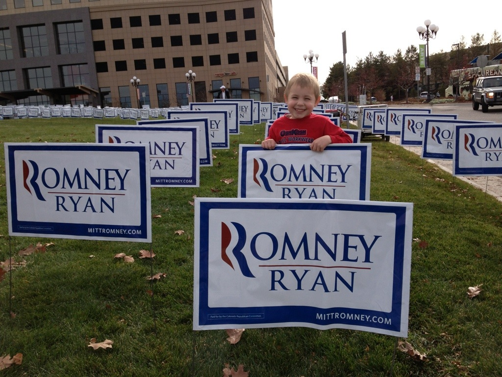 J in a field of Romney signs.